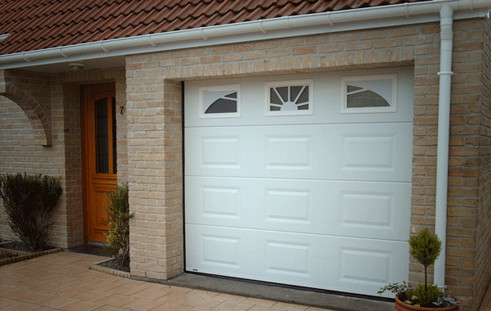 Porte de garage sectionnelle disponible sur le site d - Fixation porte de garage basculante ...